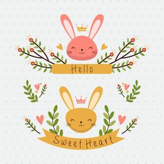 Deux têtes de lapin mignonnes avec fleurs et ruban