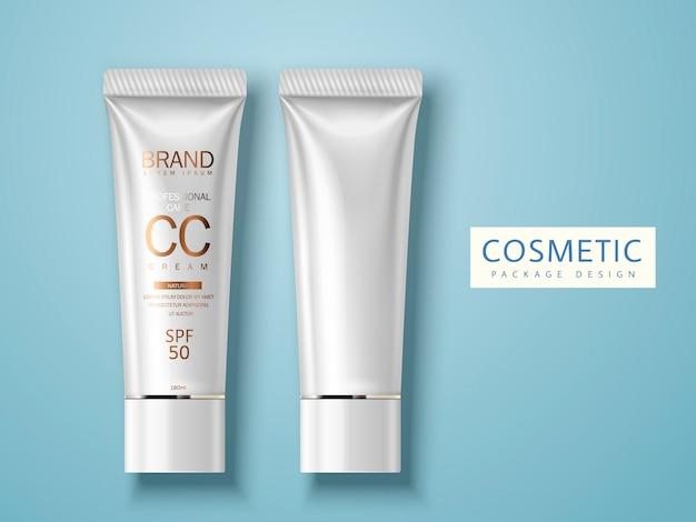 Deux tubes en plastique, un blanc et un autre pour l'utilisation de l'emballage de crème cosmétique, fond bleu clair isolé