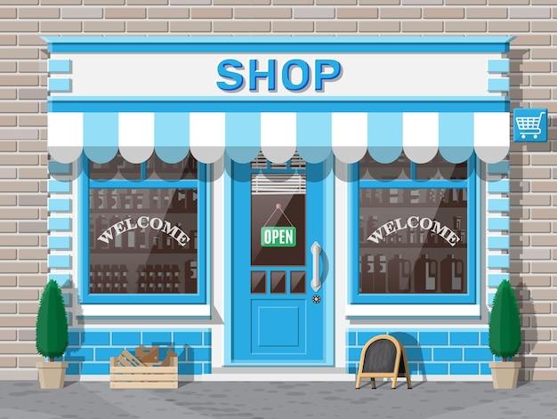 Devanture de magasin vide avec fenêtre et porte. façade en bois et brique. vitrine en verre de boutique. petit extérieur de magasin de style européen. commercial, immobilier, marché ou supermarché. illustration vectorielle plane