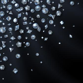 Diamants chers et brillants, isolés sur fond noir.