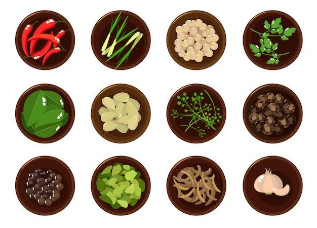 Différentes épices sur des assiettes