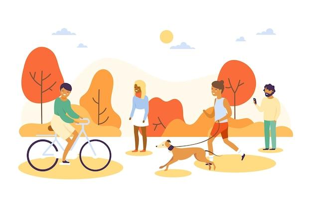 Différentes personnes marchant dans le parc
