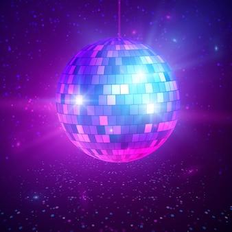 Disco ou boule à facettes avec des rayons lumineux