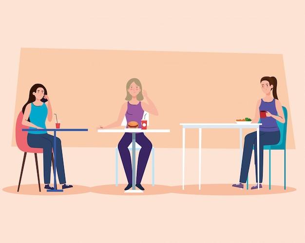 Distance sociale dans un restaurant nouveau concept, femmes aux tables, protection, prévention du coronavirus covid 19