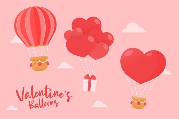 Divers ballons flottant dans le ciel attaché avec des coffrets cadeaux et des coeurs rouges le jour de la saint-valentin