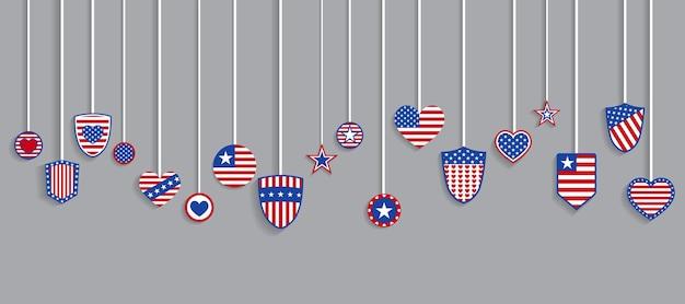 Divers symboles des etats-unis dans des couleurs rouges et bleues accrochant sur des cordes