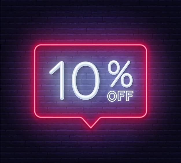 Dix pour cent de réduction en néon sur fond de mur de brique.