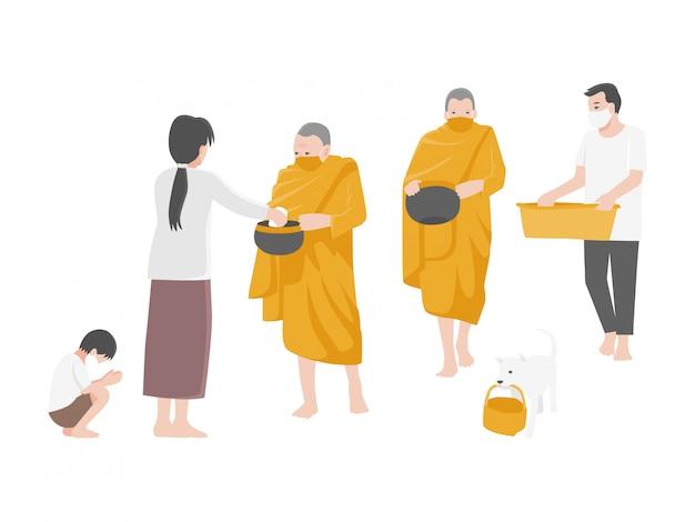 Donnez l'aumône, les gens méritent en offrant de la nourriture aux moines