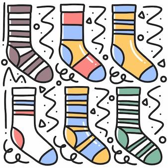 Doodle de chaussette dessiné main sertie d'icônes et d'éléments de conception