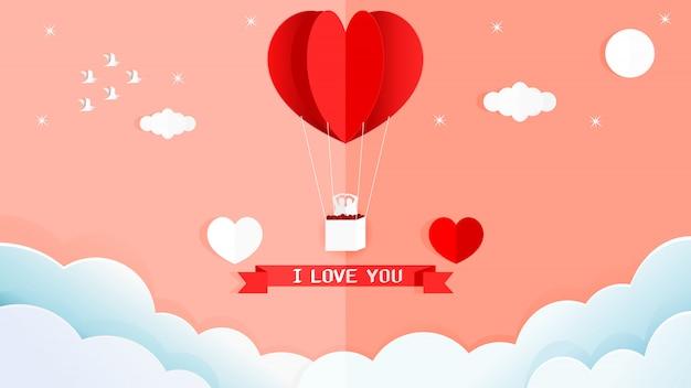 Douce carte de saint valentin de ballon en forme de coeur rouge sur le mur