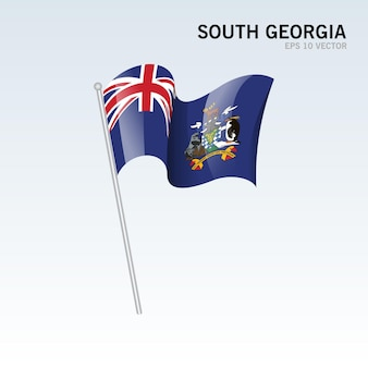 Drapeau agitant la géorgie du sud isolé sur gris