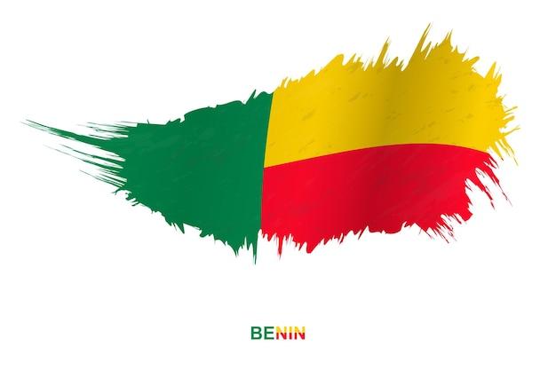 Drapeau du bénin dans un style grunge avec effet ondulant, drapeau de coup de pinceau vectoriel grunge.