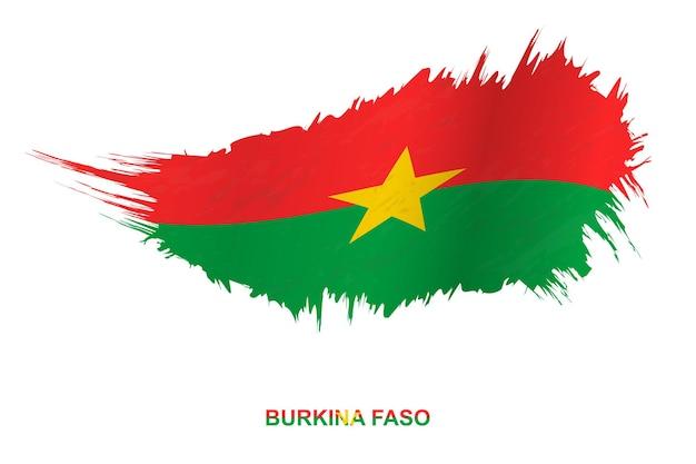 Drapeau du burkina faso dans un style grunge avec effet ondulant, drapeau de coup de pinceau vectoriel grunge.