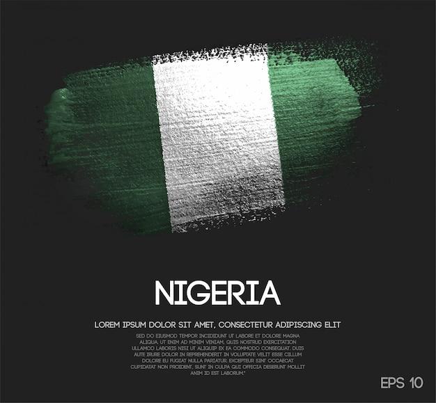 Drapeau du nigéria fait de peinture de pinceau d'étincelle de scintillement