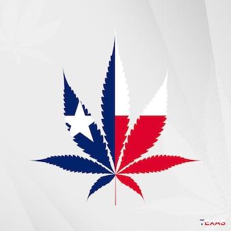 Drapeau du texas en forme de feuille de marijuana. le concept de légalisation du cannabis au texas.