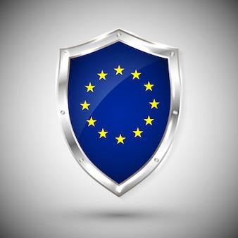 Drapeau de l'europe sur le bouclier brillant en métal. collection de drapeaux sur le bouclier sur fond blanc. objet isolé abstrait.
