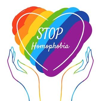 Drapeau de la fierté et amour arrêtent le concept d'homophobie