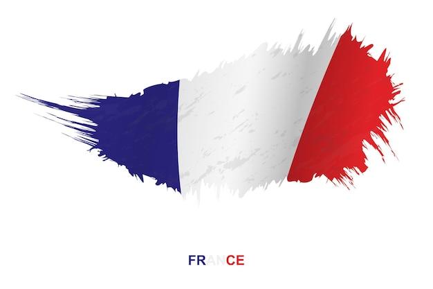Drapeau de la france dans un style grunge avec effet ondulant, drapeau de coup de pinceau vectoriel grunge.