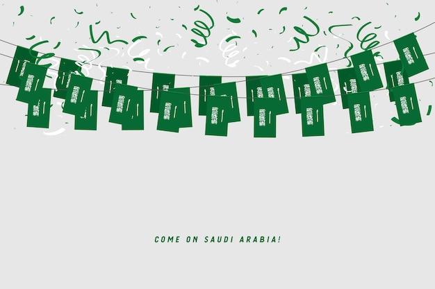 Drapeau de la guirlande de l'arabie saoudite avec des confettis sur fond gris.