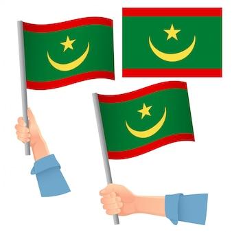 Drapeau de la mauritanie en jeu à la main