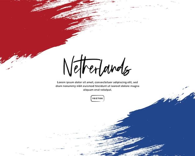 Drapeau néerlandais avec effet de coup de pinceau et texte