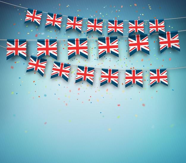 Drapeaux colorés de la grande-bretagne, royaume-uni avec des confettis sur fond bleu.