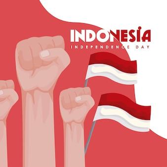 Drapeaux et mains de la fête de l'indépendance de l'indonésie
