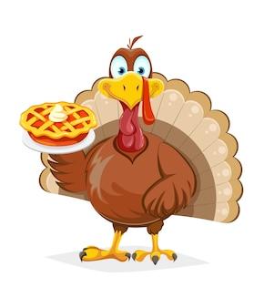 Drôle d'oiseau de dinde de thanksgiving tenant une tarte à la citrouille