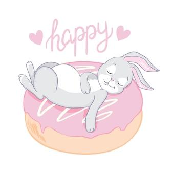 Drôle de petit bébé lapin sur donut isolé sur blanc