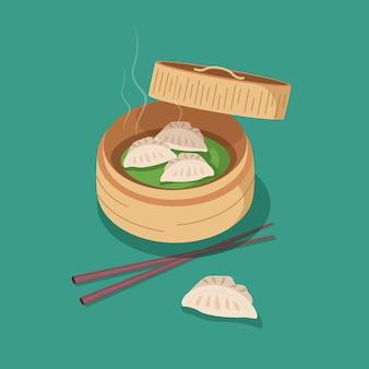 Dumplings cuits à la vapeur remplis de viande dans une boîte en bois avec des baguettes