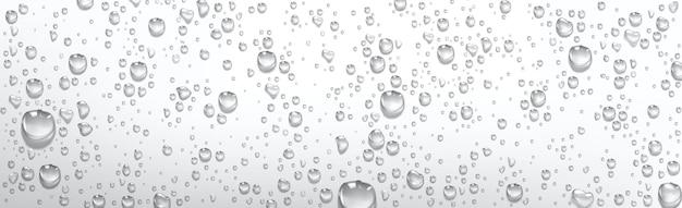 L'eau de condensation tombe. gouttelettes de pluie avec réflexion de la lumière