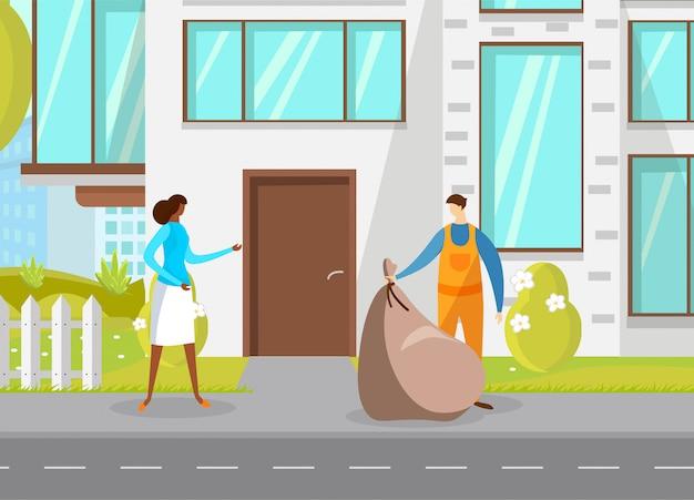 Un éboueur ramassant des ordures de la ville dans un sac en plastique