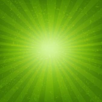 Éclat vert avec des rayons