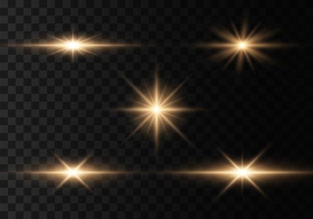 Des éclats d'or brillants éblouissent les rayons lumineux des éclairs scintillent des lumières dorées des lignes lumineuses