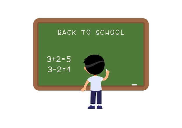 Écolier debout près de tableau noir élève de l'école élémentaire résolvant un exercice mathématique