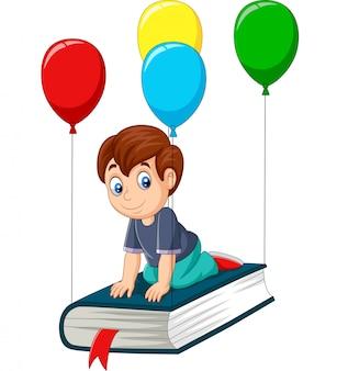 Écolier dessin animé voler sur un livre