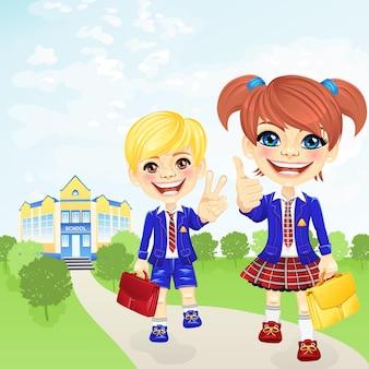 Écolière heureuse de vecteur et écolier près de l'école