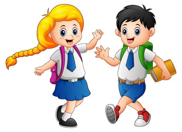 Les écoliers heureux vont à l'école