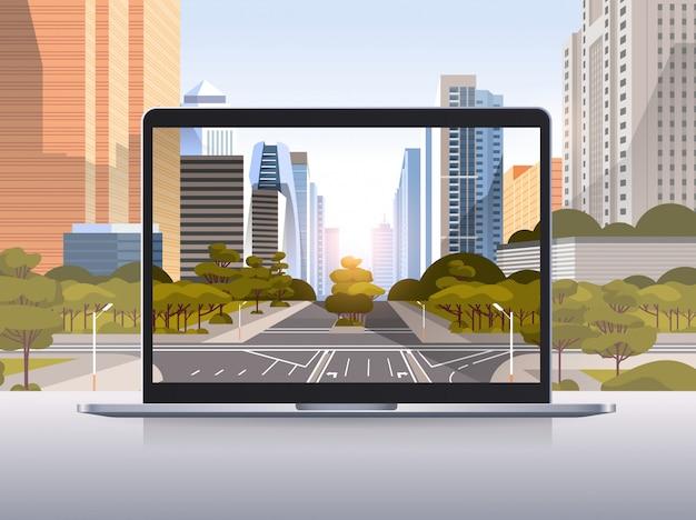 Écran d'ordinateur portable transparent mur de paysage urbain concept de gadgets et appareils réalistes