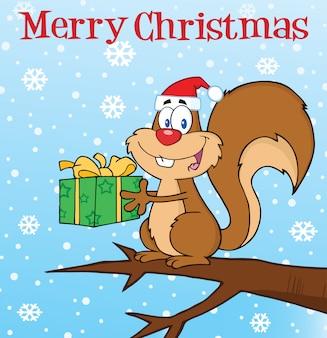 Écureuil heureux avec santa hat tenant un cadeau sous le texte de joyeux noël.