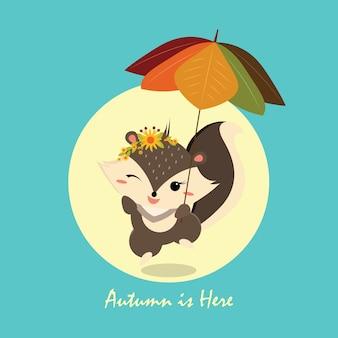 Écureuil heureux tenant un parapluie de feuille