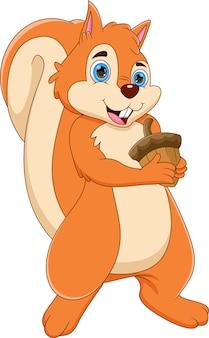 Écureuil mignon de dessin animé tenant un écrou