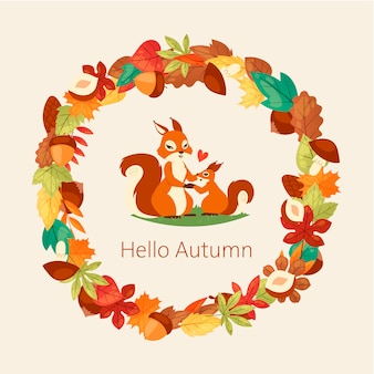 Écureuils entourés de feuilles d'automne, de branches de glands, de noix et de champignons