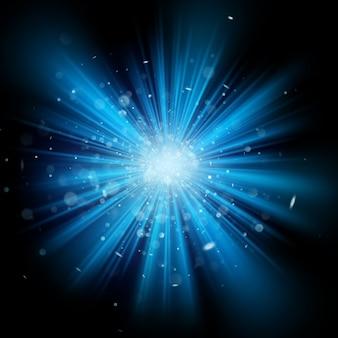 Effet de fond de paillettes de lumière bleue sur fond noir. explosion de poussière d'étoile. et comprend également