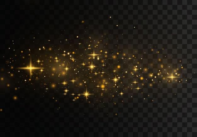 Effet de lumière élégant abstrait de noël sur un fond transparent. des étincelles jaune poussière jaune et des étoiles dorées brillent d'une lumière spéciale.