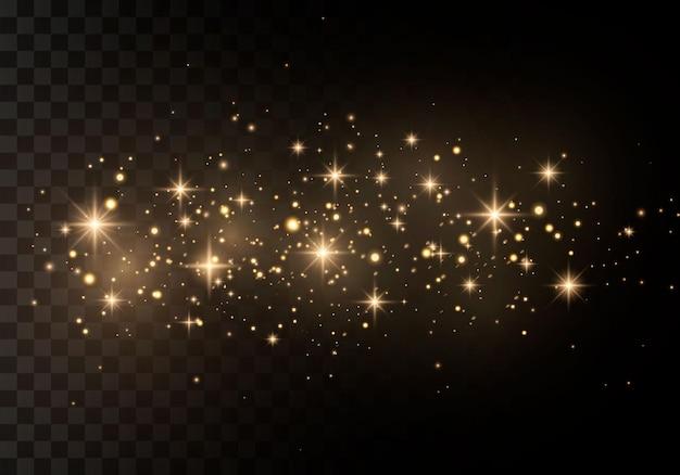 Effet de lumière. des étincelles jaune poussière jaune et des étoiles dorées brillent d'une lumière spéciale.