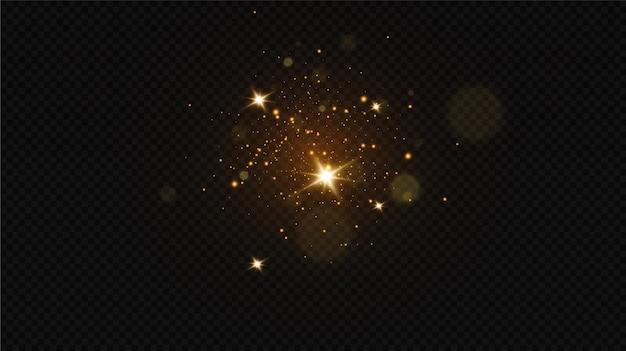Effet de lumière lueur.particules de poussière magiques scintillantes.les étincelles de poussière et les étoiles dorées brillent.