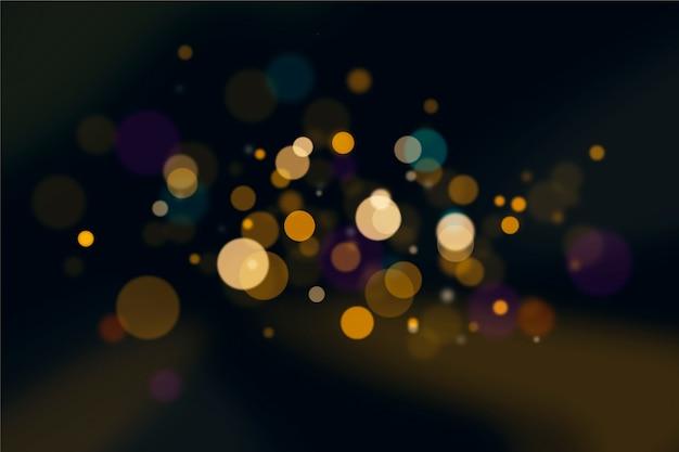 Effet de lumières bokeh sur la conception de papier peint sombre