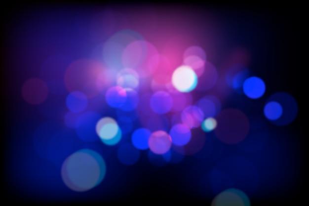 Effet de lumières bokeh sur fond sombre