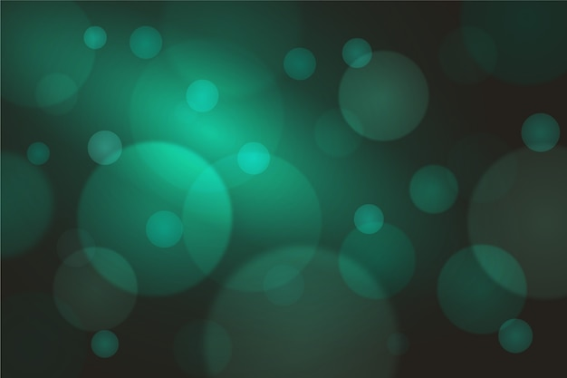 Effet de lumières vertes bokeh sur fond sombre